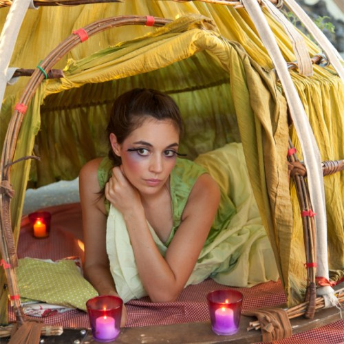 Madam Jardin in her skirt tent, getting ready for bed.