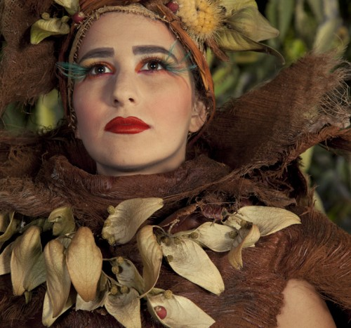 Queen Gabriella San Nicholas wears feather eyelashes to honor her ancestor Juana Maria
