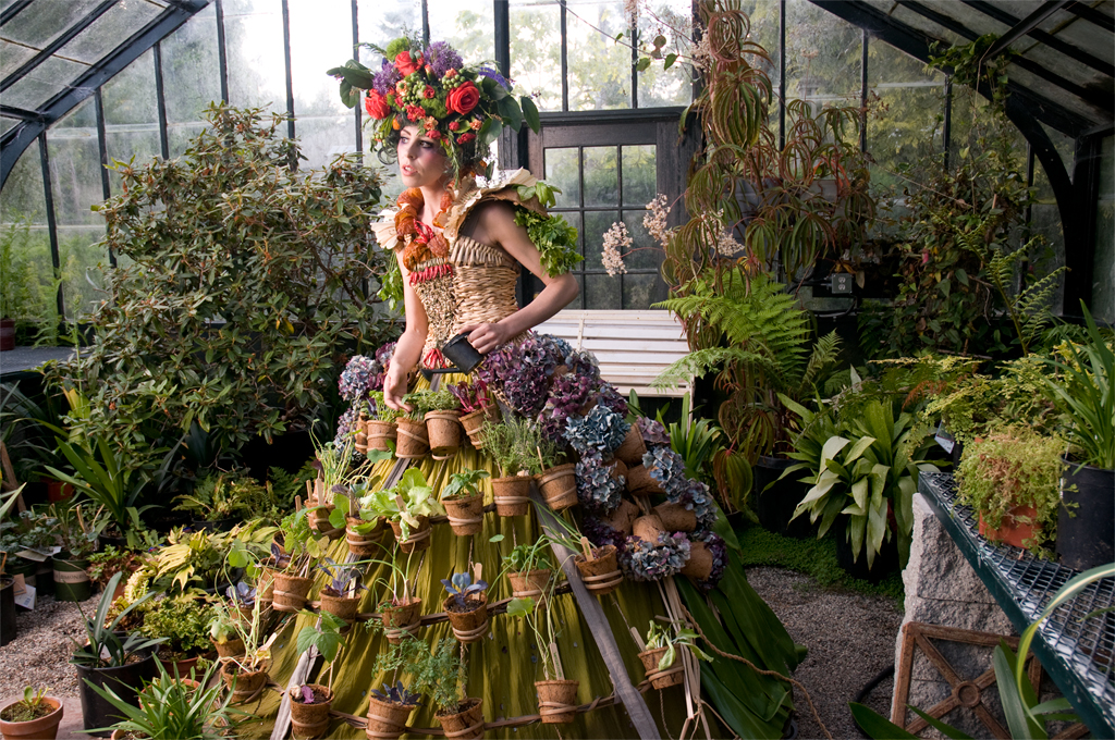 The Mobile Garden Dress is based on a hoop skirt that supports over forty potted edible plants.