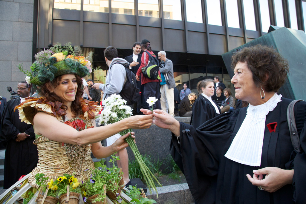In Montreal, Madame Jardin joined a group of lawyers protesting against the Bill 78. She handed them daisies to show her support.