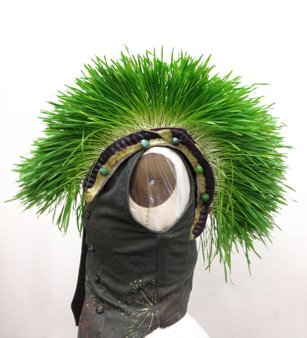 Our agent of propagation also wears a secondhand vest adorned with épaulettes of fresh Wheat Grass.