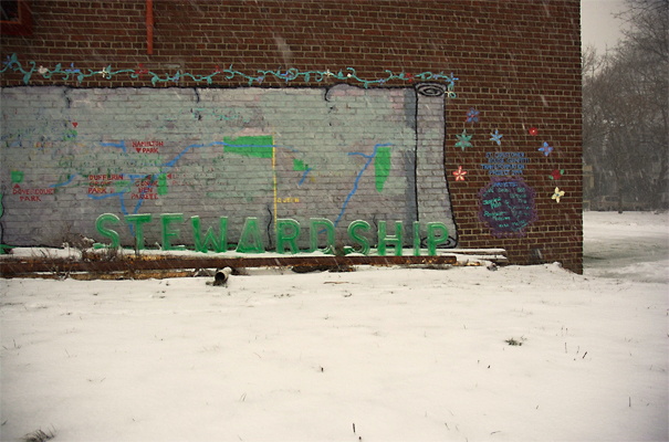 Stewardship - Ice text installed in front of an old mural depicting the neighborhood parks. Evidence of the public being engaged in their parks.
