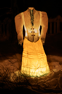 Victorian Ice Dress Lantern - Lit at night with candles the frozen garment comes to life, an apparition of the historic gold rush, now reduced to a whitewashed tourist attraction.