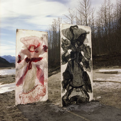 River Sprites - Two tall ice blocks of deconstructed garments installed on the banks of the Lillooet River in Pemberton Meadows. They stand as beacons of light emerging from the river.