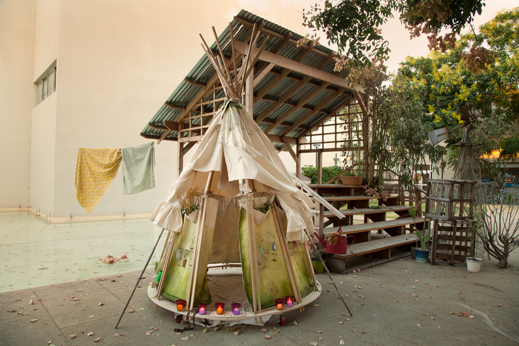 The skirt converts into a teepee shaped shelter. The design is inspired by the propagation mechanism of the Pine Cone
