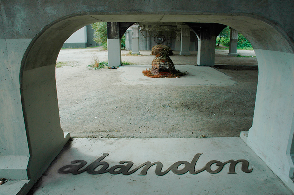 Abandon - Visual poetry made from mud on site. Cracked over days. Smashed up by cyclists.