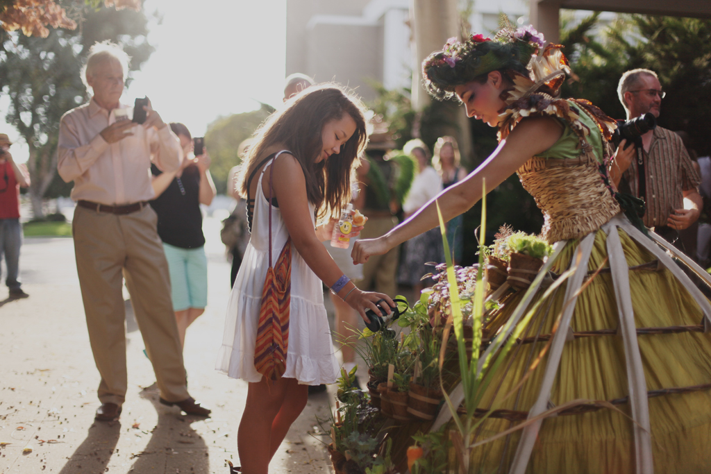 The public interacts directly with the dress by watering and tasting the plants. These simple acts allow people to further engage in conversations about gardening, plants and food. Photo: E Stoner CA