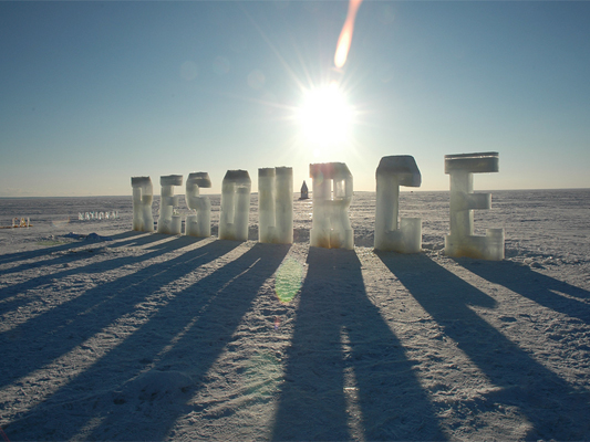 Solar Resources - Cast ice text throws large shadows on the lake. Who owns the sun, the lake, the snow or the wind?