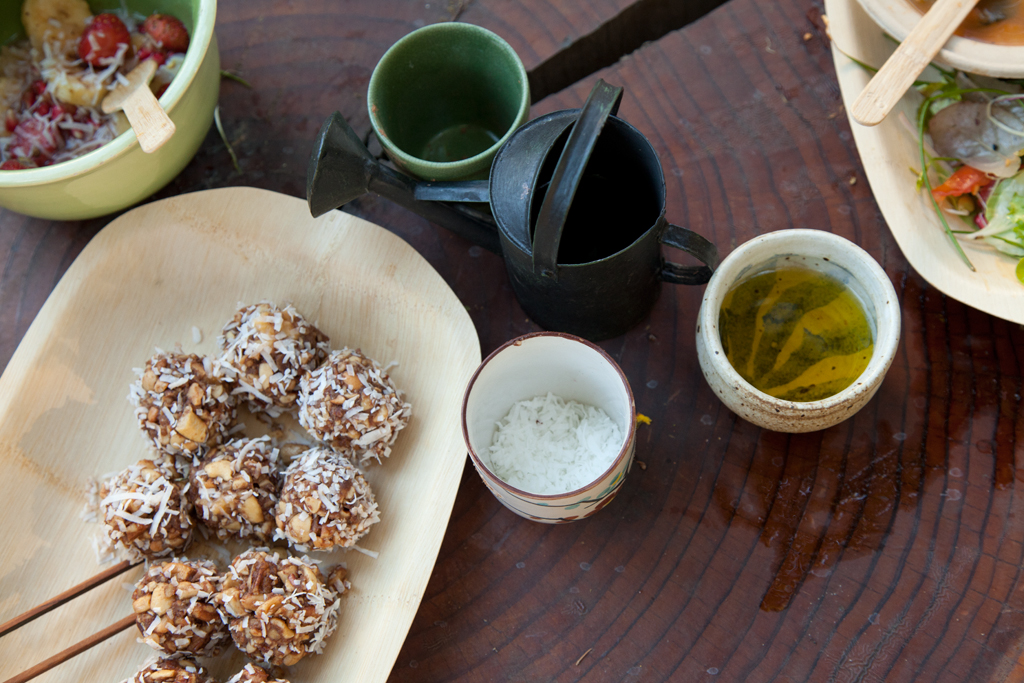 Protein balls made with coconut, cashews and cocoa grounded together with a motor and pestle.