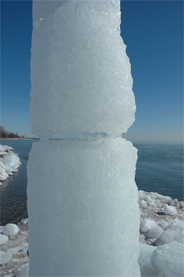 View, Column Melt - Filling the forms at different times created striations in the ice, which become more apparent as it melts.