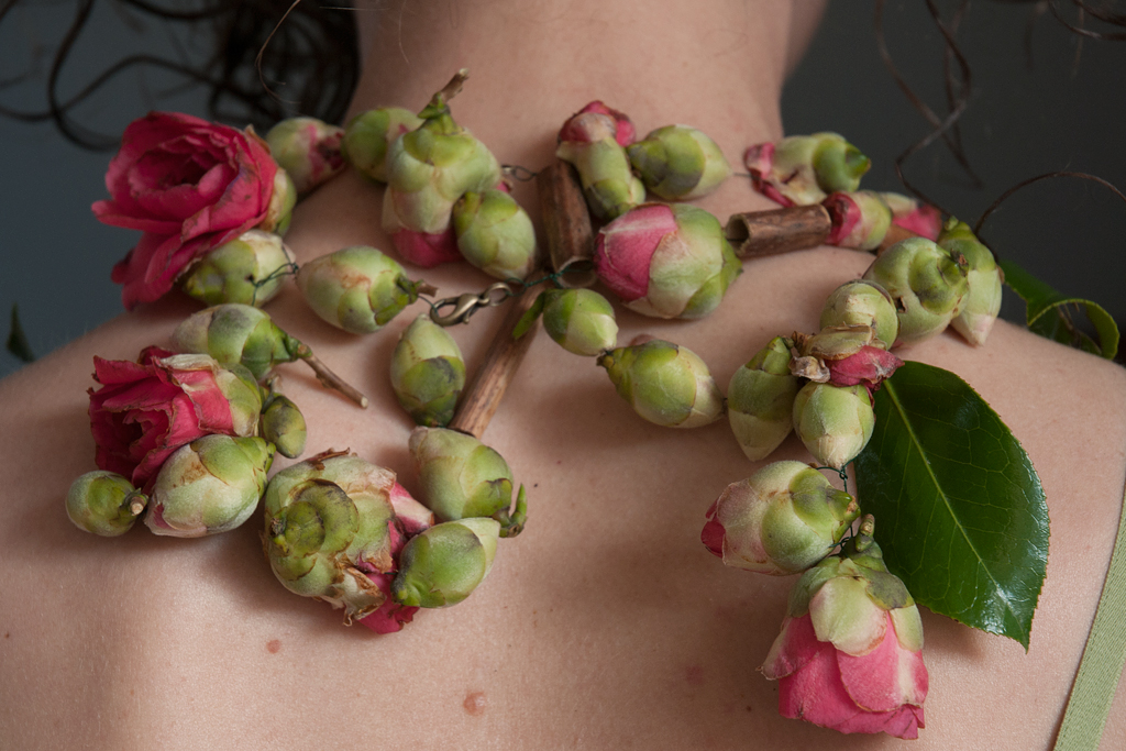 The necklace is made from strung Camellia flower buds and leaves.