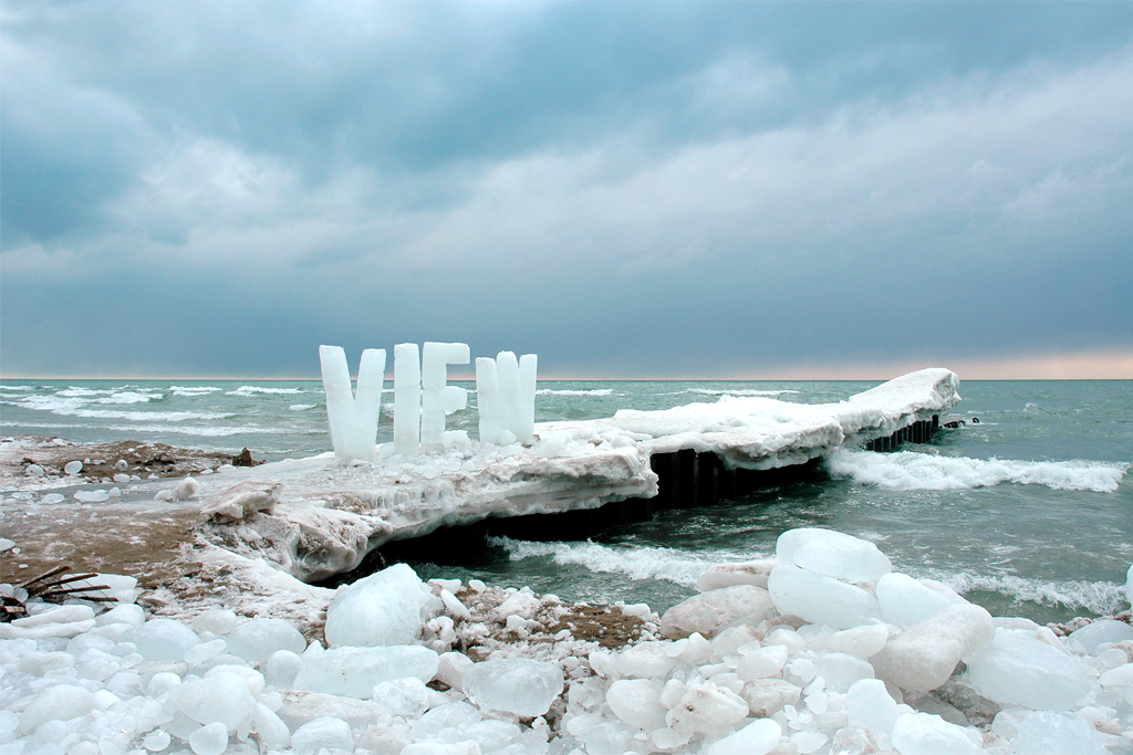 View - Large ice text on the shore of cold and blustery Lake Ontario. View questions how we look at the landscape; how nature becomes a commodity.