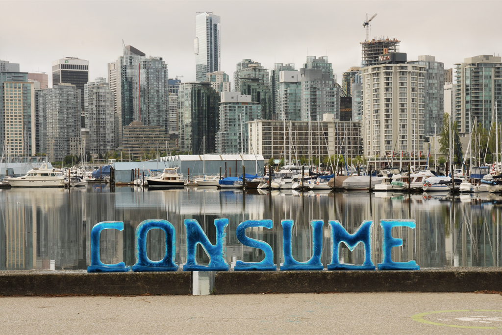 Consume - Ice text in the front of the ever expanding Coal Harbor real-estate boom.