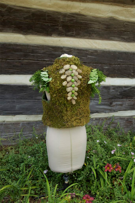 The dress comprises a vest made from live moss, seen here from the back.