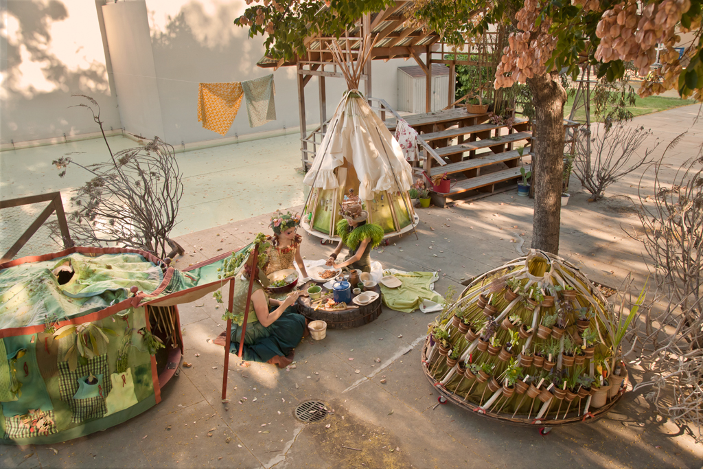 The Urban Foragers set up camp with their skirts as shelters.