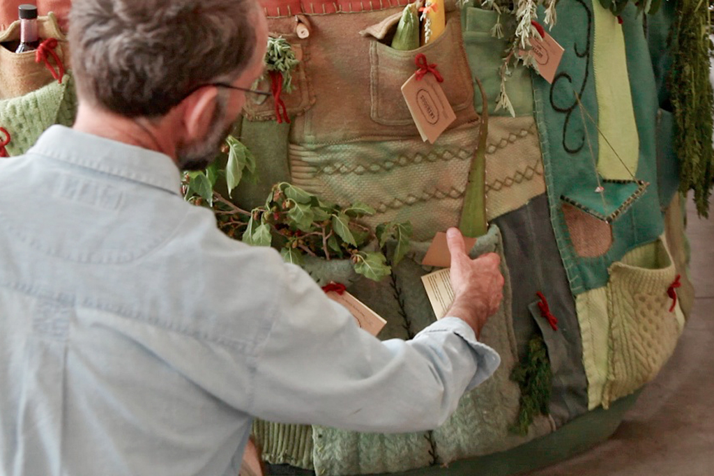 The public is invited to engage with the dress through its numerous tags, which contain vital information about the plant's nutrition and history.