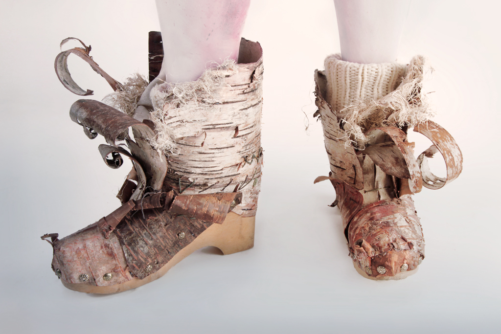 The boots were made from Birch bark over a wooden clog and lined with linen fabric.