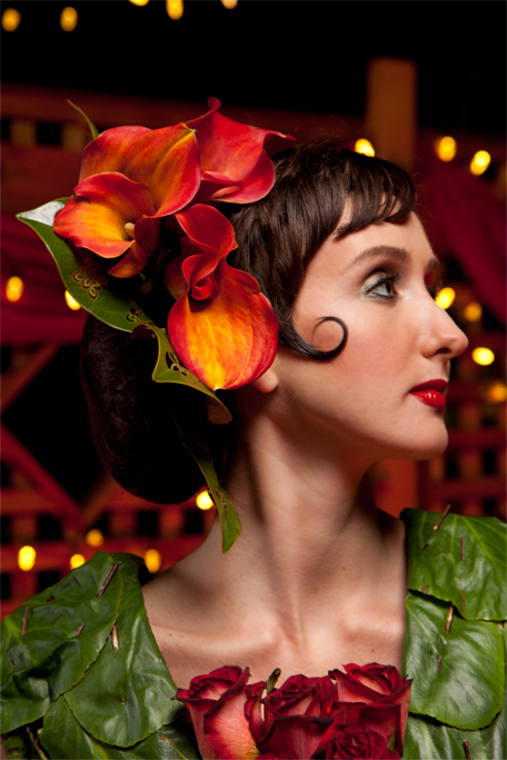 She wears Calla Lilies in her hair and the traditional Peineta, a comb fabricated from Tortoise shell, is replaced with one made of stamped Magnolia leaves.