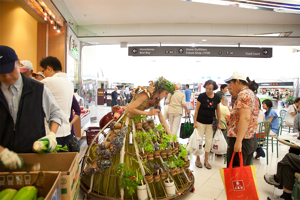 The Mobile Garden Dress interacts with shoppers to identify edible plants and talk about local food sourcing.
