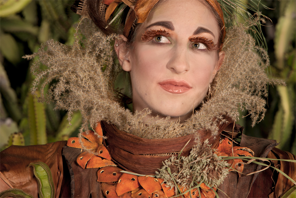 The Mandarin Princess wears butterfly wings on her eyelids and her face is framed by a high collar of lace-like Miscanthus sinensis (Maiden Grass)