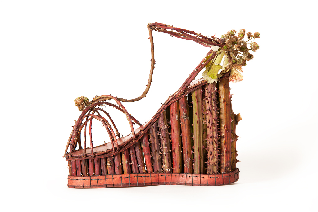 The Blackberry Platform Sandal, in all its thorny splendor exemplifies the adage: to suffer for fashion. Made from Blackberry vines, leather, Linen thread and thorns.