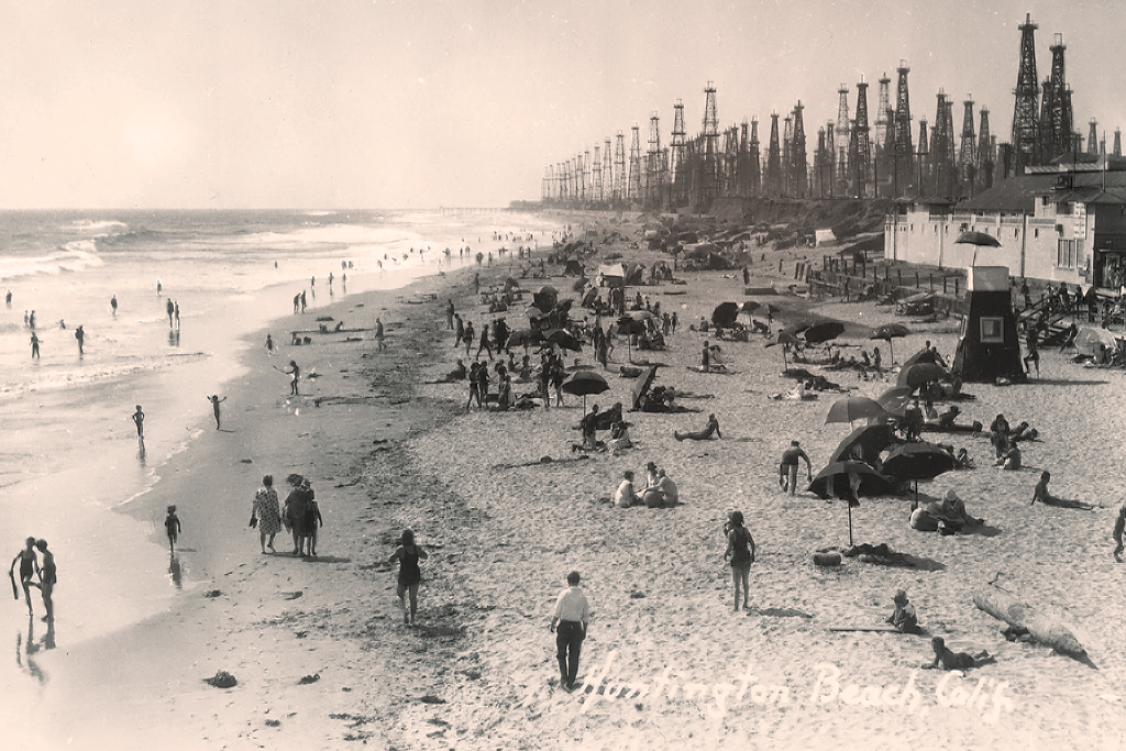 "The oil boom of 1919 changed the California coast forever. ""View from the Huntington Beach Pier"" from the Orange County Archives."