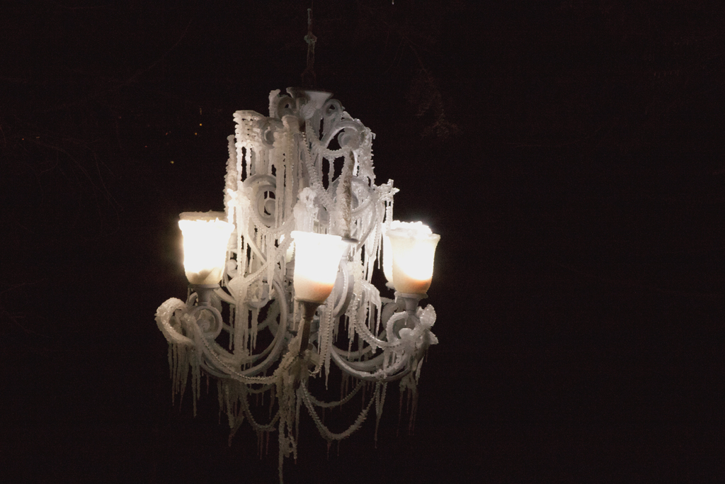 The ice chandelier lit at night swayed gently in the wind, creating an eery mesmerizing effect.