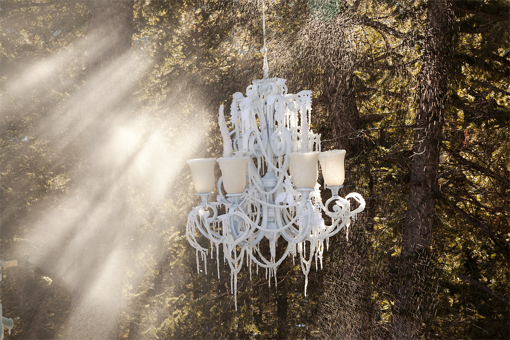 The Chandelier was hung in the trees and sprayed with water, which froze into icicles.