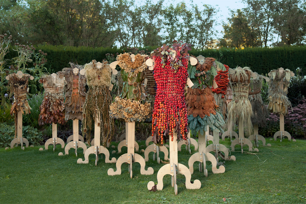 The installation grew over a period of 2 months, gradually occupying the perennial garden in a triangular formation with the last completed dress at the very front.