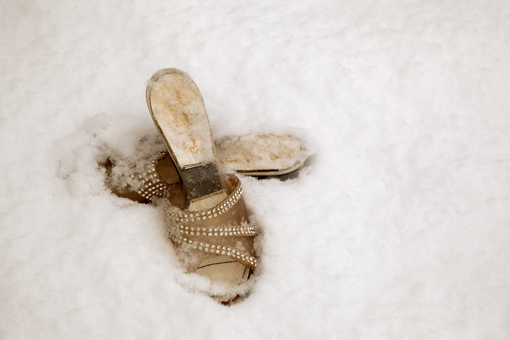 Pair of 1950s slingback shoes. Footprints snowed over.