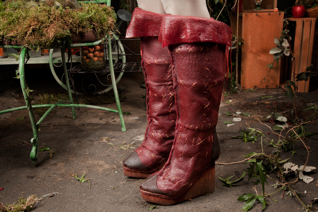Undeterred by the collapse of the fast fashion industry she fabricates her boots out of pomegranate fruit leather on a cork platform heel.