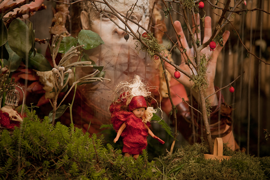 Persephone adapts to her isolation and angst by building terrariums with figurines of herself recounting the days of abundance in the orchard.
